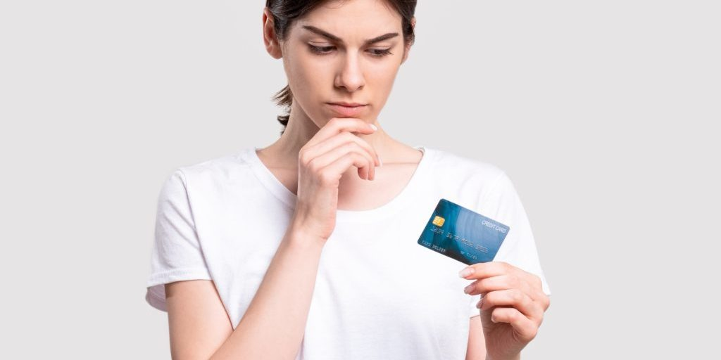 Bank,Deposit.,Financial,Crisis.,Doubtful,Woman,With,Credit,Card,Concerned
