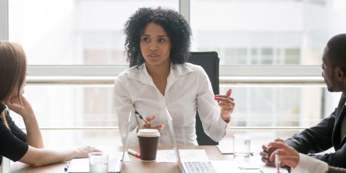 Horizontal,Photo,People,Sitting,At,Boardroom,African,Business,Woman,Talking